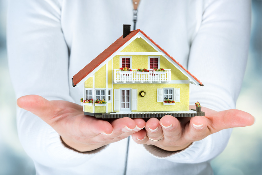 house in woman hands - real estate concept